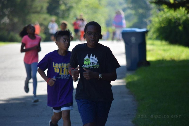 Little Kent 2 finishes first in the Losing 2 Live Kid's 1K Fun Run